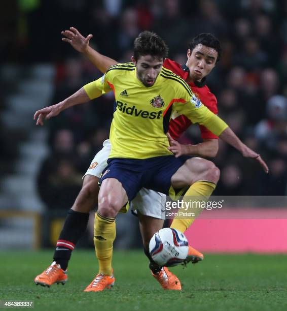 Rafael da Silva of Manchester United in action with Fabio Borini of Sunderland during the Capital One Cup semifinal second leg at Old Trafford on...