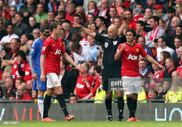 Rafael Da Silva of Manchester United is sent off by referee Howard Webb during the Barclays Premier League match between Manchester United and...