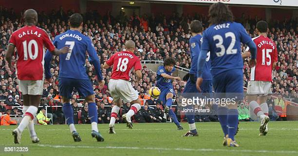 Rafael Da Silva of Manchester United scores their first goal during the Barclays Premier League match between Arsenal and Manchester United at the...