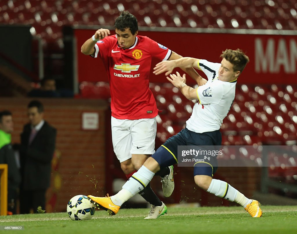 Rafael da Silva of Manchester United U21s in action with Will Miller of Tottenham Hotspur U21s during the Barclays U21 Premier League match between Manchester United U21s and Tottenham Hotspur U21s at Old Trafford on March 10, 2015 in Manchester, England.