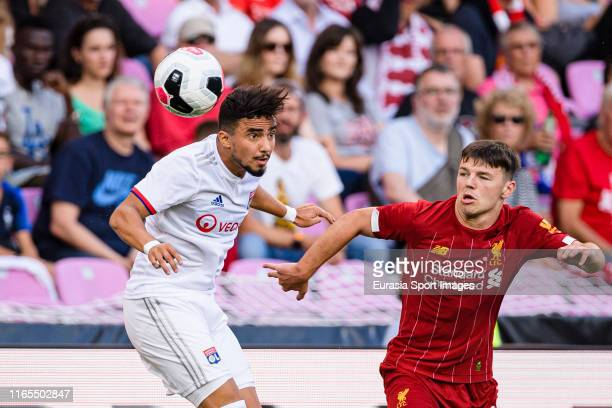 Rafael da Silva of Olympique Lyon plays against Bobby Dundan of Liverpool during the Pre-Season Friendly match between Liverpool FC and Olympique...