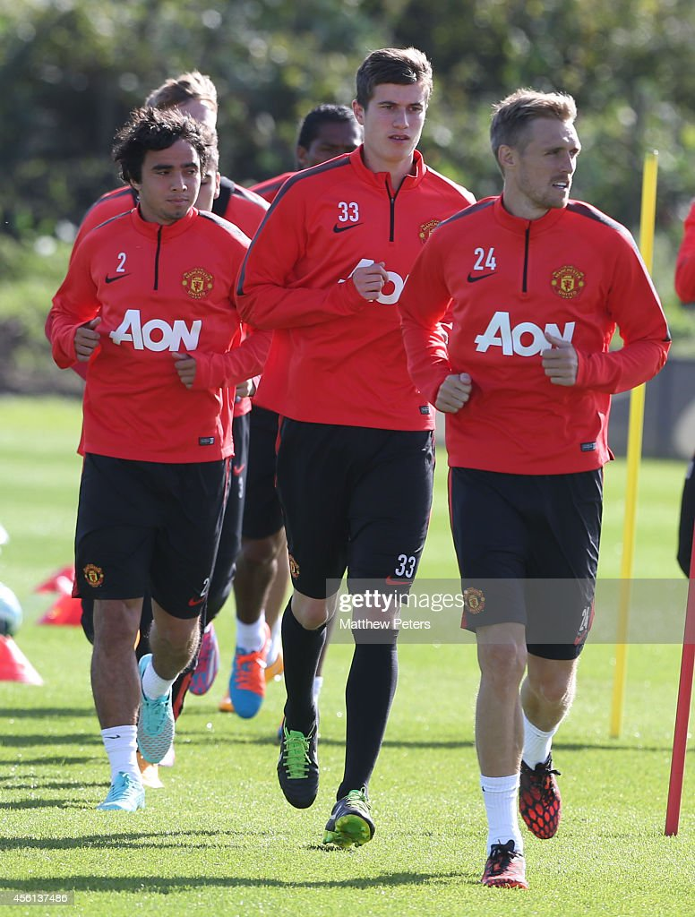 Rafael da Silva, Patrick McNair and Darren Fletcher of Manchester United in action during a first team training session at Aon Training Complex on September 26, 2014 in Manchester, England.
