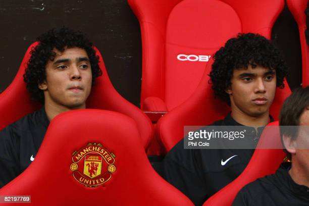 Rafael Da Silva sits on the bench beside his twin brother and team mate Fabio Da Silva of Manchester United prior to the Pre Season Friendly match...