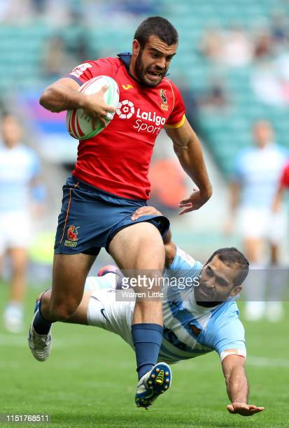 Rafael de Santiago of Spain evades a tackle by Gaston Revol of Argentina to score a try during day two of the HSBC London Sevens at Twickenham...