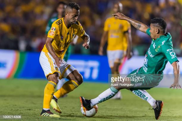 Rafael De Souza of Tigres fights for the ball with Alexander Mejia of Leon during the 1st round match between Tigres UANL and Leon as part of the...