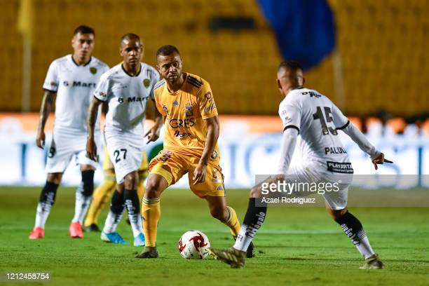 Rafael De Souza of Tigres fights for the ball with Jefferson Intriago of Juárez during the 10th round match between Tigres UANL and FC Juarez as part...