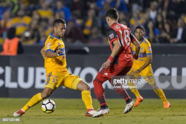 Rafael De Souza of Tigres fights for the ball with Marky Delgado of Toronto during the quarterfinals second leg match between Tigres UANL and Toronto...