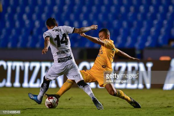 Rafael De Souza of Tigres fights for the ball with William Mendieta of Juárez during the 10th round match between Tigres UANL and FC Juarez as part...