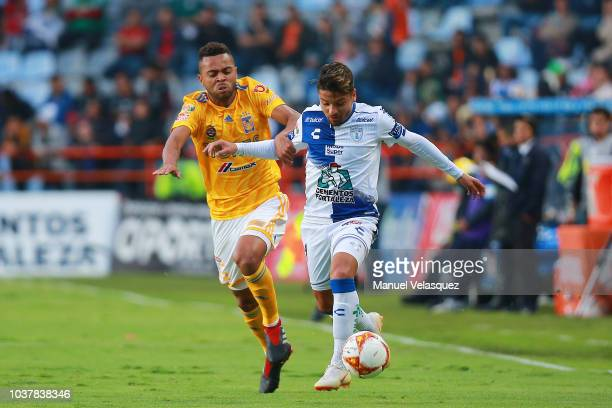 Rafael De Souza of Tigres struggles for the ball against Sebastian Palacios of Pachuca during the 9th round match between Pachuca and Tigres UANL as...