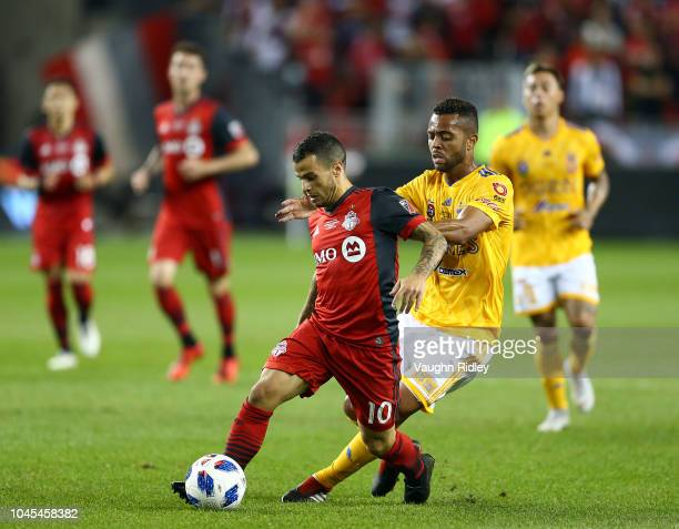Rafael De Souza of Tigres UANL battles for the ball with Sebastian Giovinco of Toronto FC during the first half of the 2018 Campeones Cup Final at...