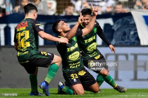 Rafael Delgado of Defensa y Justicia celebrates after scoring his side's first goal with the teammate Nicolas Fernandez and Ignacio Aliseda during...