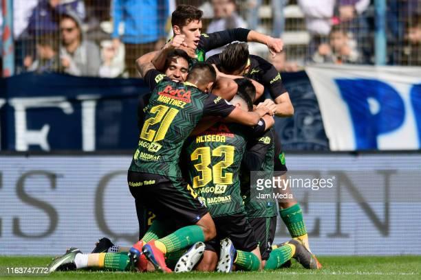 Rafael Delgado of Defensa y Justicia celebrates with teammates after scoring his side's first goal during a match between Gimnasia y Esgrima La Plata...