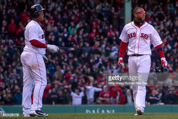 Rafael Devers and Eduardo Nunez of the Boston Red Sox argue a call during the ninth inning of the Opening Day game against the Tampa Bay Rays on...