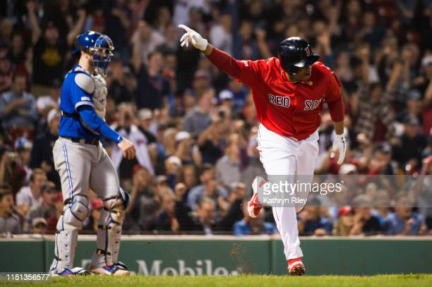 Rafael Devers celebrates as he hit the game tying RBI single in the eighth inning against the Toronto Blue Jays at Fenway Park on June 21 2019 in...