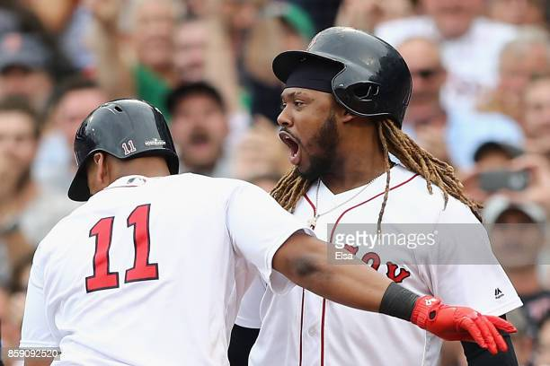 Rafael Devers celebrates with Hanley Ramirez of the Boston Red Sox after hitting a tworun home run in the third inning against the Houston Astros...