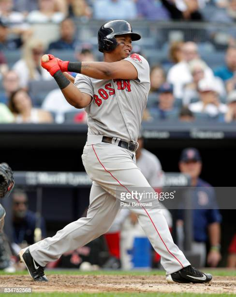 Rafael Devers of the Boston Red Sox bats in an MLB baseball game against the New York Yankees on August 12 2017 at Yankee Stadium in the Bronx...