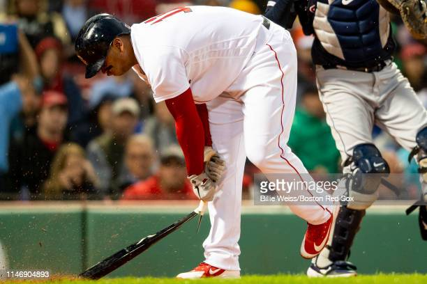 Rafael Devers of the Boston Red Sox breaks his bat after striking out during the fifth inning of a game against the Cleveland Indians on May 29 2019...