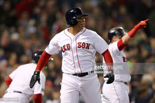 Rafael Devers of the Boston Red Sox celebrate scoring a run during the third inning against the Houston Astros in Game Two of the American League...