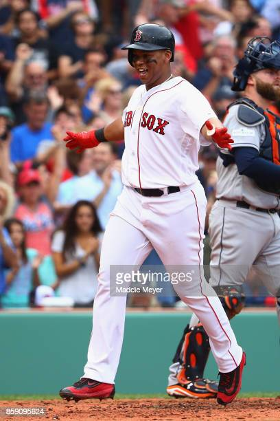 Rafael Devers of the Boston Red Sox celebrates after hitting a tworun home run in the third inning against the Houston Astros during game three of...
