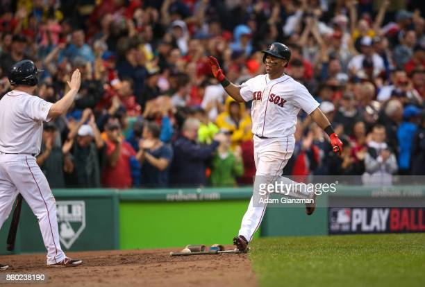 Rafael Devers of the Boston Red Sox celebrates after hitting an insidethepark home run in the bottom of the ninth inning of Game 4 of the American...