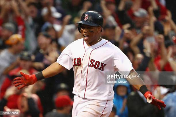 Rafael Devers of the Boston Red Sox celebrates after hitting an inside the park home run in the ninth inning against the Houston Astros during game...