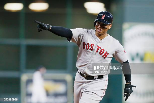 Rafael Devers of the Boston Red Sox celebrates as he runs the bases after hitting a threerun home run in the sixth inning against the Houston Astros...