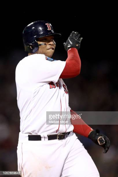 Rafael Devers of the Boston Red Sox celebrates his fifth inning RBI single against the Los Angeles Dodgers in Game One of the 2018 World Series at...
