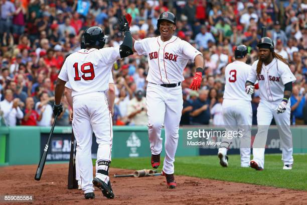 Rafael Devers of the Boston Red Sox celebrates with Jackie Bradley Jr #19 after hitting a tworun home run in the third inning against the Houston...