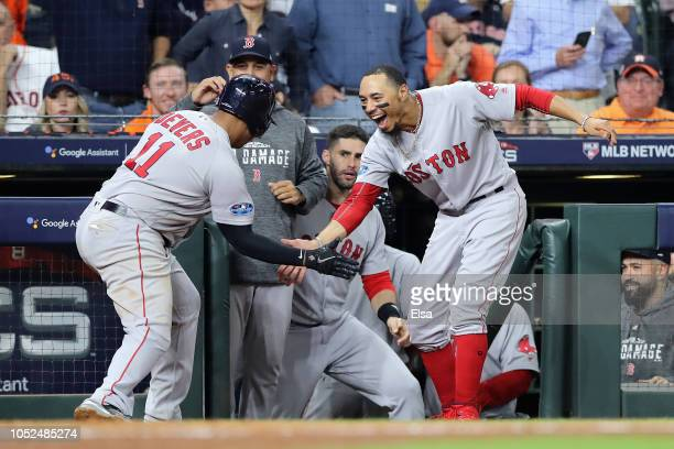 Rafael Devers of the Boston Red Sox celebrates with Mookie Betts at the dugout after hitting a threerun home run in the sixth inning against the...