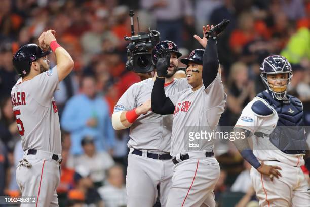 Rafael Devers of the Boston Red Sox celebrates with teammates after hitting a threerun home run in the sixth inning against the Houston Astros during...