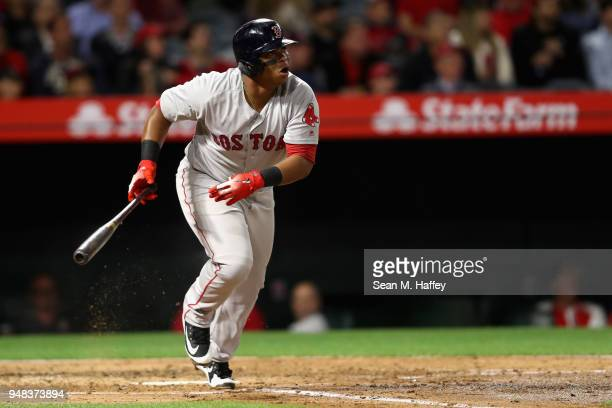 Rafael Devers of the Boston Red Sox connects for a grandslam during the third inning of a game against the Los Angeles Angels of Anaheim at Angel...