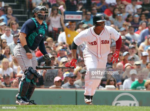 Rafael Devers of the Boston Red Sox doubles in a run against the Seattle Mariners in the fifth inning at Fenway Park on June 24 2018 in Boston...