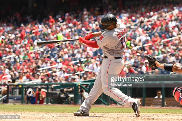 Rafael Devers of the Boston Red Sox doubles to start the seventh inning during a baseball game against the Washington Nationals at Nationals Park on...