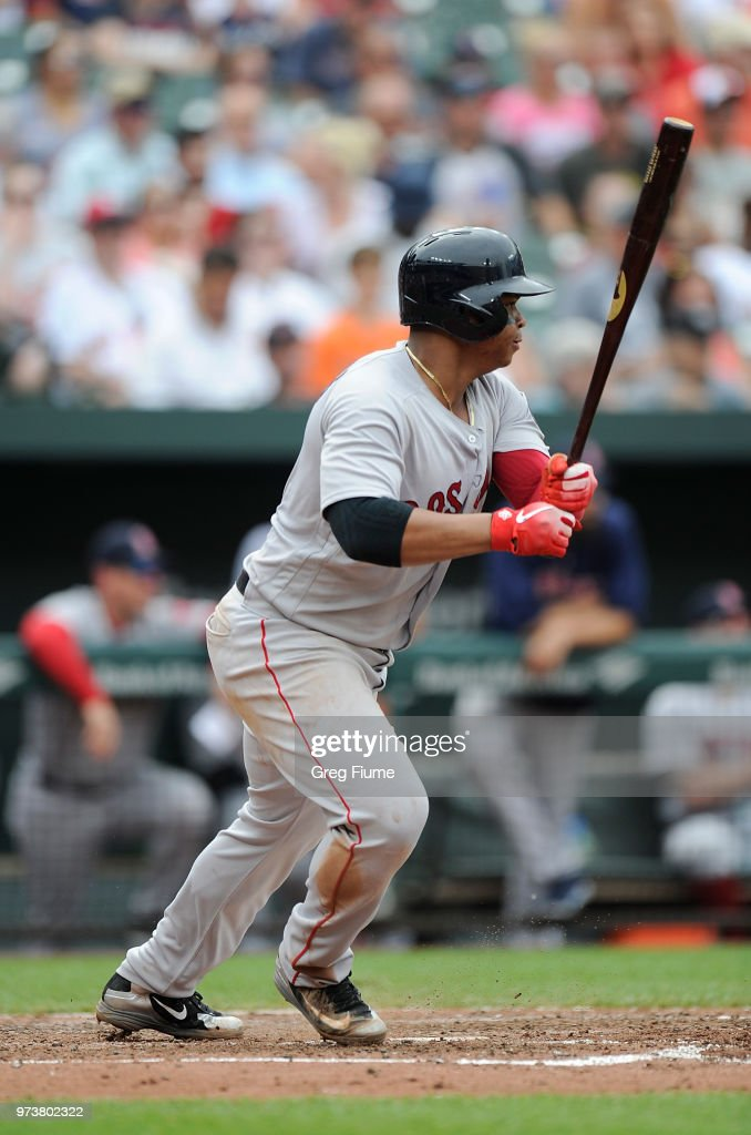 Rafael Devers #11 of the Boston Red Sox drives in a run with a single in the fifth inning against the Baltimore Orioles at Oriole Park at Camden Yards on June 13, 2018 in Baltimore, Maryland.