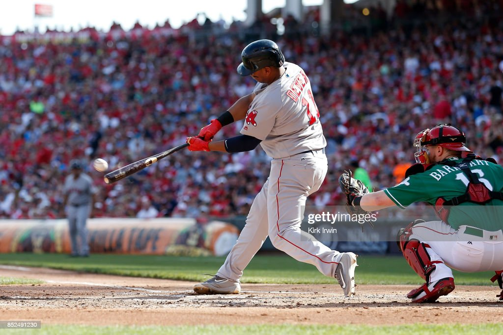 Rafael Devers #11 of the Boston Red Sox hits a double during the second inning of the game against the Cincinnati Reds at Great American Ball Park on September 23, 2017 in Cincinnati, Ohio.