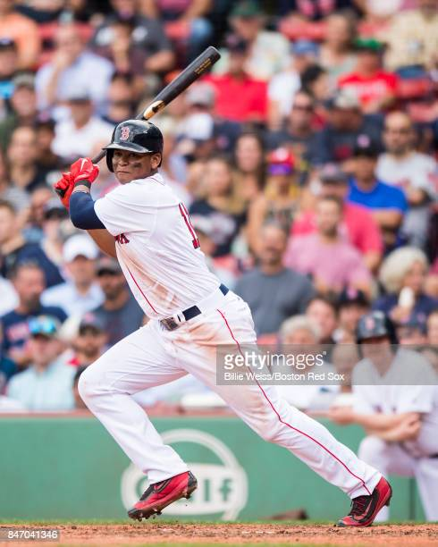 Rafael Devers of the Boston Red Sox hits a double during the seventh inning of a game against the Oakland Athletics on September 14 2017 at Fenway...