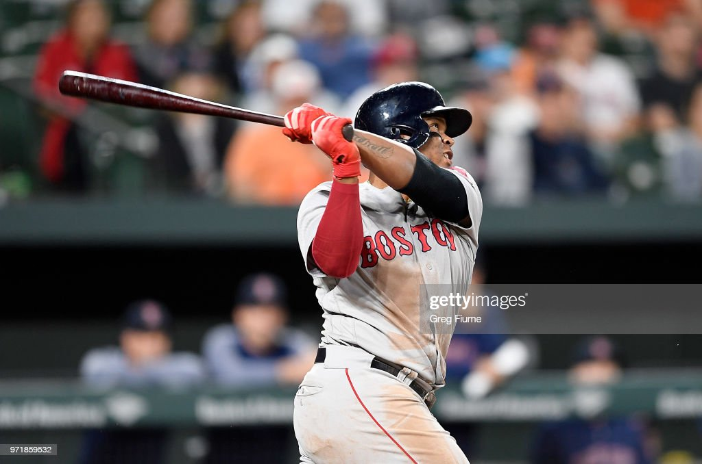 Rafael Devers #11 of the Boston Red Sox hits a double in the 12th inning against the Baltimore Orioles at Oriole Park at Camden Yards on June 11, 2018 in Baltimore, Maryland.