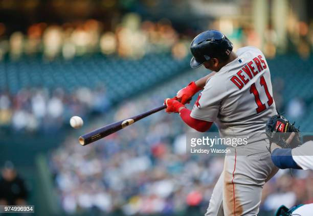 Rafael Devers of the Boston Red Sox hits a double in the fourth inning off of Felix Hernandez of the Seattle Mariners at Safeco Field on June 14 2018...