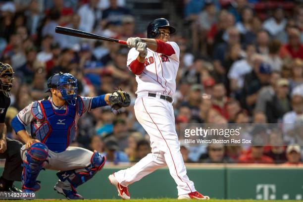 Rafael Devers of the Boston Red Sox hits a game tying RBI triple during the third inning of a game against the Texas Rangers on June 11 2019 at...