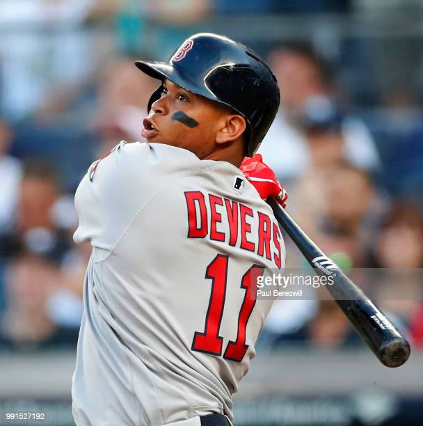 Rafael Devers of the Boston Red Sox hits a grand slam home run in the first inning in an MLB baseball game against the New York Yankees on June 30...