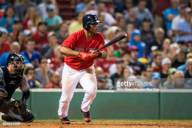 Rafael Devers of the Boston Red Sox hits a single during the eighth inning of a game against the New York Yankees on August 18 2017 at Fenway Park in...