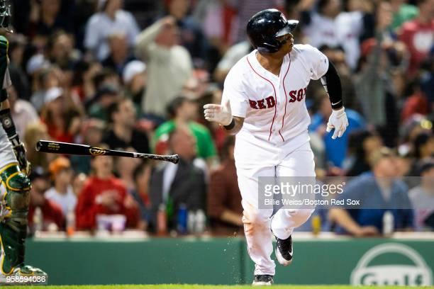 Rafael Devers of the Boston Red Sox hits a solo home run during the seventh inning of a game against the Oakland Athletics on May 14 2018 at Fenway...