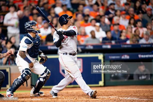 Rafael Devers of the Boston Red Sox hits a three run home run during the sixth inning of game five of the American League Championship Series against...