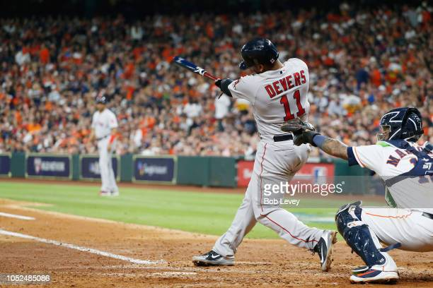 Rafael Devers of the Boston Red Sox hits a threerun home run in the sixth inning against the Houston Astros during Game Five of the American League...