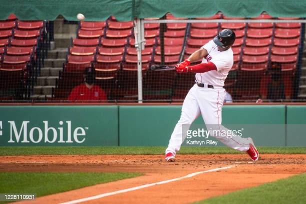 Rafael Devers of the Boston Red Sox hits a two run home run in the third inning against the Philadelphia Phillies at Fenway Park on August 19 2020 in...