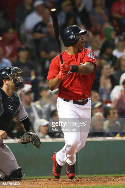 Rafael Devers of the Boston Red Sox hits a tworun home run in the second inning of a game against the New York Yankees at Fenway Park on August 18...