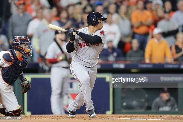 Rafael Devers of the Boston Red Sox hits a tworun RBI single in the first inning against the Houston Astros during Game Four of the American League...