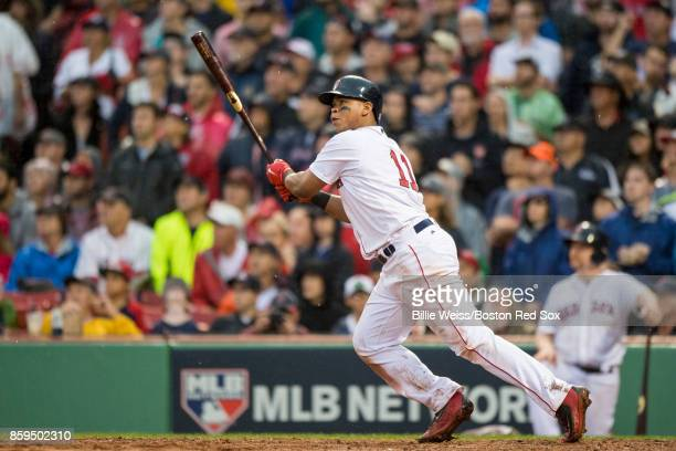 Rafael Devers of the Boston Red Sox hits an inside the park home run during the ninth inning of game four of the American League Division Series...