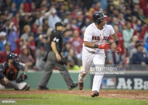 Rafael Devers of the Boston Red Sox hits an insidethepark home run against the Houston Astros in the ninth inning of game four of the American League...
