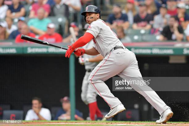 Rafael Devers of the Boston Red Sox hits an RBI double during the first inning against the Cleveland Indians at Progressive Field on August 13 2019...